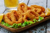 picture of squid  - fried squid rings breaded with lemon and salad - JPG