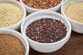 black quinoa and other gluten free grains (amaranth, millet, teff brown rice)  in small ceramic bowls
