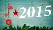 2015 against christmas decorations over wooden planks