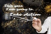 Businessman about to write something against colourful fireworks exploding on black background