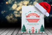 Merry christmas message against santa hat on poster