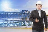 Environmental Engineering Man Standing In Front Of Waterworks In Heavy Industry Plant And Sign Good