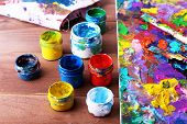 Abstract painting on canvas with cans, brush and rag on wooden table background
