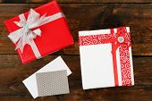Gift boxes with card on wooden background