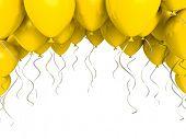Yellow party balloons on white background