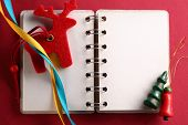 Open Notebook With Ribbons And Reindeer
