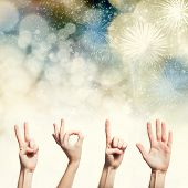 Happy new year with hands forming number 2015 on sparkling holiday background