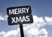Merry Xmas sign with clouds and sky background