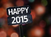 Happy 2015 sign with colorful background with defocused lights