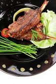 served savory plate: meat ribs with chives and red hot peppers