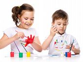 Cute Boy And Girl Playing With Paints