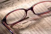 Glasses on Financial Newspaper