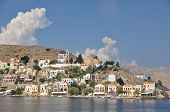 picture of sm  - Gialos ( the lower harbour town ) and Chorio ( the upper town ) together form Symi town on the Greek island of Symi near Rhodes in the Mediterranean sea. A quite beautiful very tranquil and highly colourful place. 
