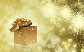abstract holiday background with golden gift box and fireworks