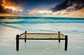 Bed On A Sandy Beach