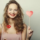 Party image. Playful young women holding a party heart.