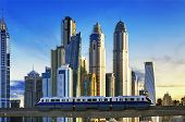 image of dubai  - View of modern buildings with subway at sunset in Dubai Marina Dubai
