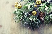 Christmas pine tree branch on wooden background