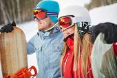 Female and male snowboarders on winter vacations