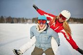 Happy couple in winter sportswear having fun outdoors