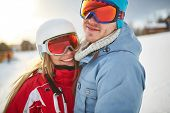 Young dates in winter sportswear and goggles
