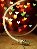Lan Cable On A Background Of Hearts.