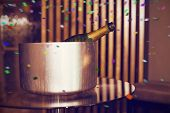 foto of champagne color  - Champagne in an ice bucket against flying colours - JPG