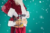 Father Christmas is wearing a tool belt against green