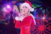 Festive blonde blowing a kiss against digitally generated colourful party text
