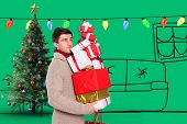 Young man with many christmas presents against green vignette