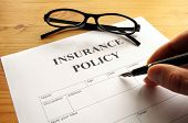 stock photo of insurance-policy  - insurance policy form on desk in office showing risk concept - JPG