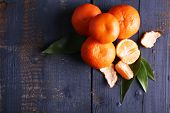 Fresh ripe mandarins on dark wooden background