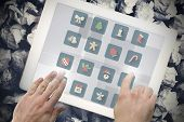 Christmas tiles against hands touching tablet screen