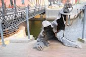 Lithuania, Klaipeda - November 17, 2014: statue of the creeping ghost on the embankment of Klaipeda, Lithuania