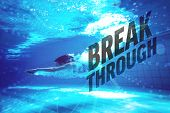 Athletic swimmer smiling at camera underwater against break through
