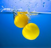 Yellow Tomatoes In Water Splash