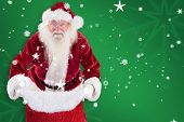 Santa open his red bag against green snowflake background