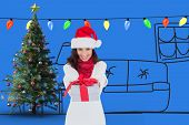 Festive brunette in santa hat giving gift against purple vignette