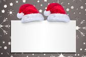 Santa hat on poster against snowflake wallpaper pattern