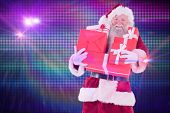 Santa carries a few presents against digitally generated cool disco background