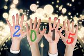 Business peoples hands against black and gold new year graphic