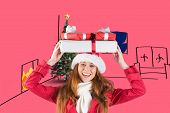 Festive redhead holding pile of gifts against pink