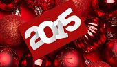 2015 against page on red christmas baubles