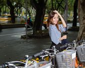 Chinese Woman By Rental Bikes