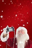 Santa Claus makes a selfie against red snowflake background