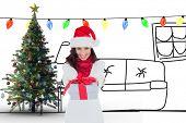 Festive brunette in santa hat giving gift against living room sketch at christmas