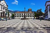 FUNCHAL, MADEIRA - OCTOBER 08, 2011: The main square of the city. Before administration building stands a memorial monument