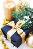 Golden Christmas Composition With Gift Box, Candle And Branch Of Spruce