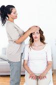 stock photo of reiki  - Calm woman receiving reiki treatment on white background - JPG