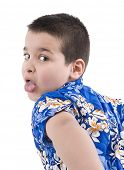 foto of sticking out tongue  - Child with hawaiian shirt sticking his tongue out over white background - JPG